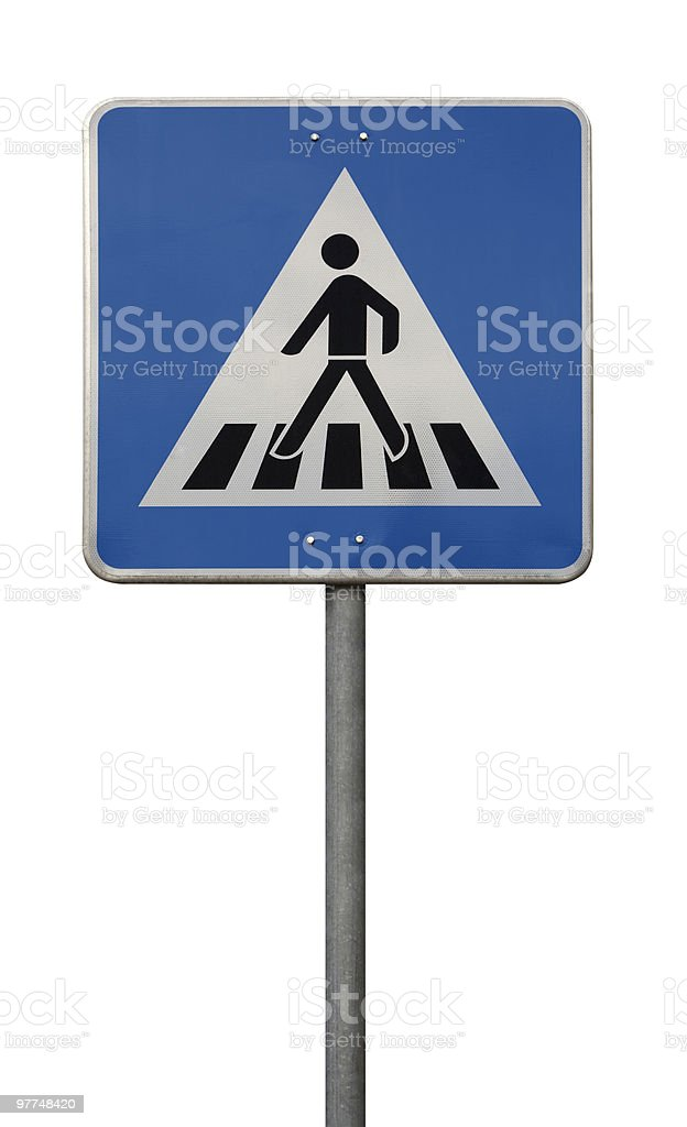 Traffic sign of a man crossing the road stock photo