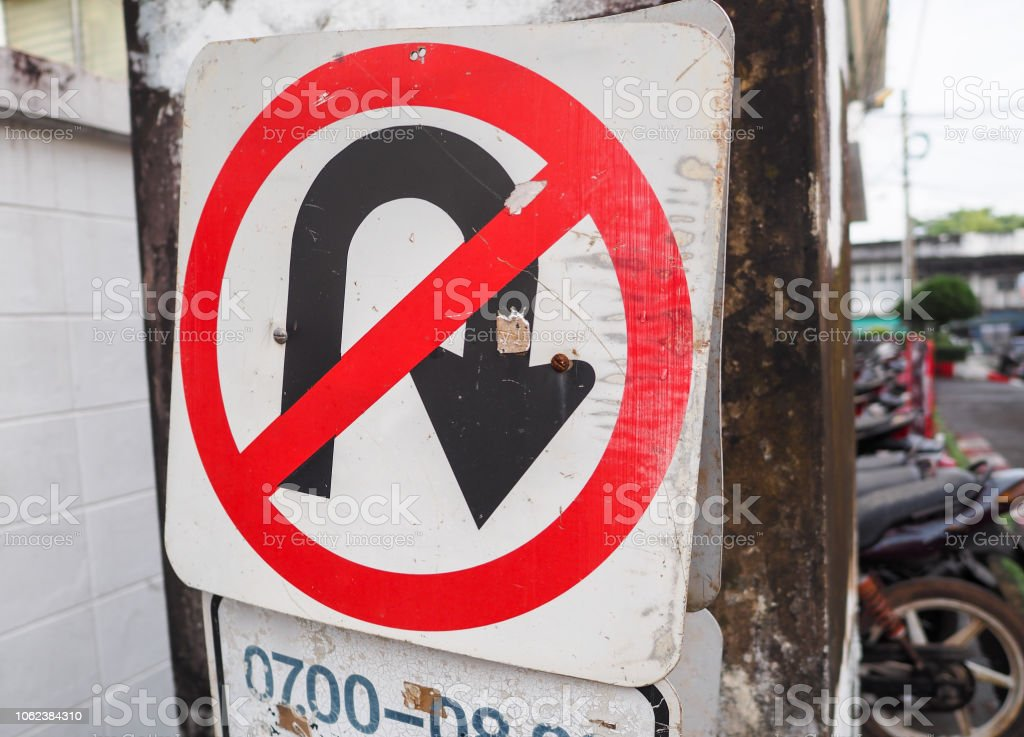 Traffic sign of no u-turn on the road in the town. stock photo