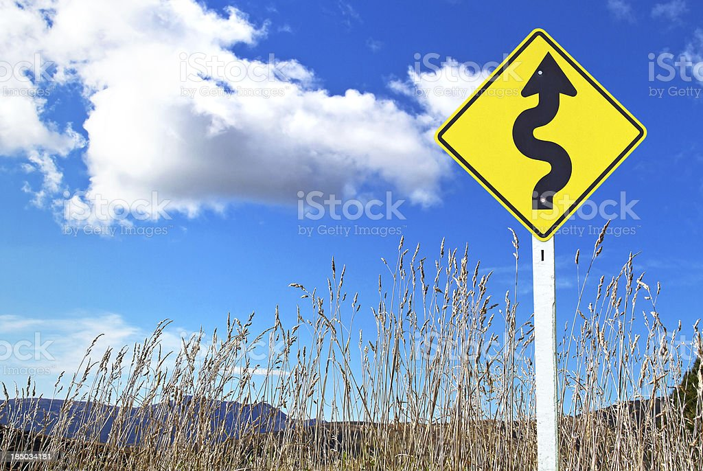 Traffic sign over dry grass Traffic sign over dry grass and blue sky Autumn Stock Photo