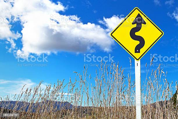 Traffic Sign Over Dry Grass Stock Photo - Download Image Now
