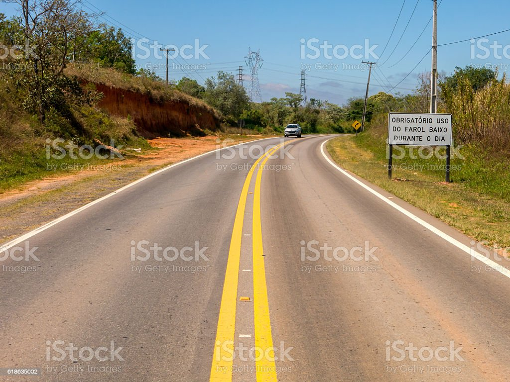 Traffic sign requiring headlights on during the day stock photo