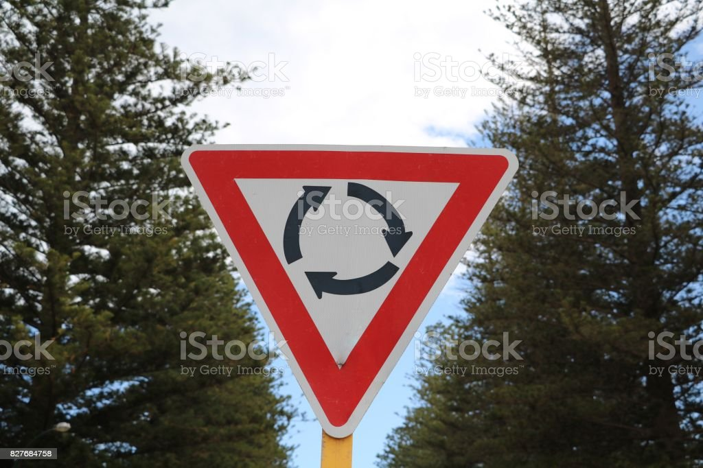Traffic sign roundabout left in Australia stock photo