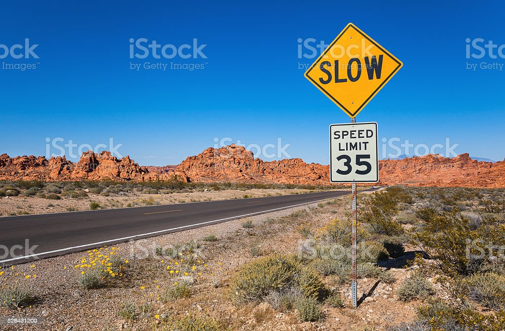 Traffic Sign Slow, Southern Nevada Traffic Sing Slow, Valley of Fire State Park, Nevada, USA Forbidden Stock Photo