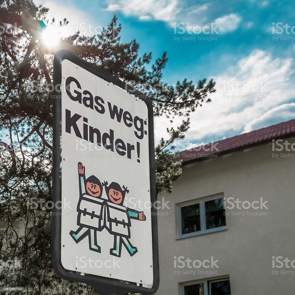 traffic sign speed limit carefully the children in German stock photo