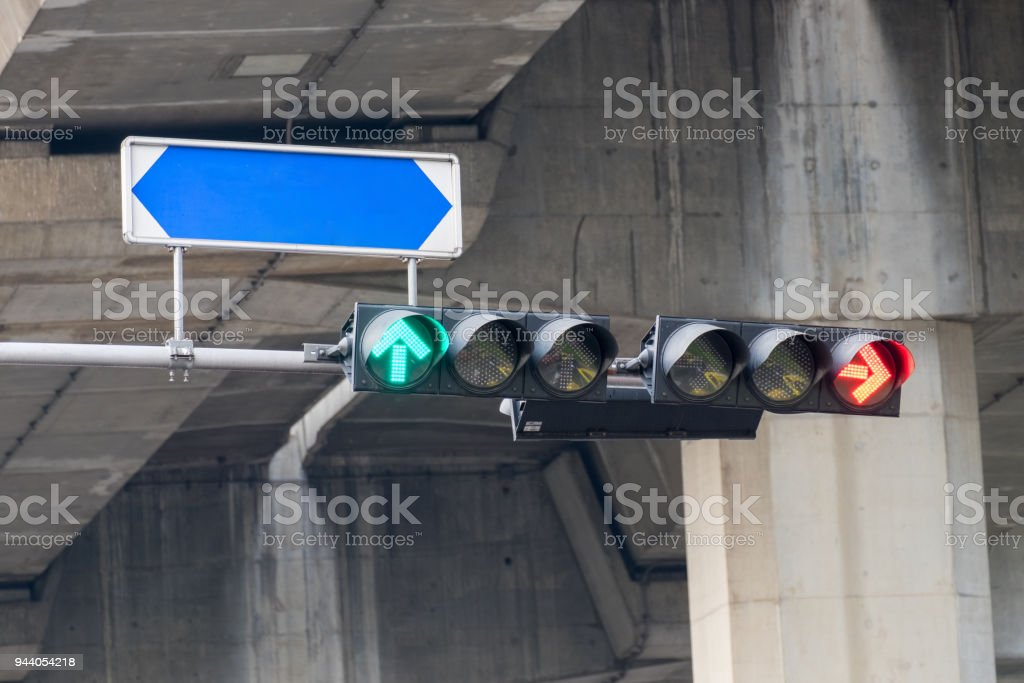 Traffic signal lights are red arrows to stop the car and green arrows to go with street names board, which installed as separate stock photo