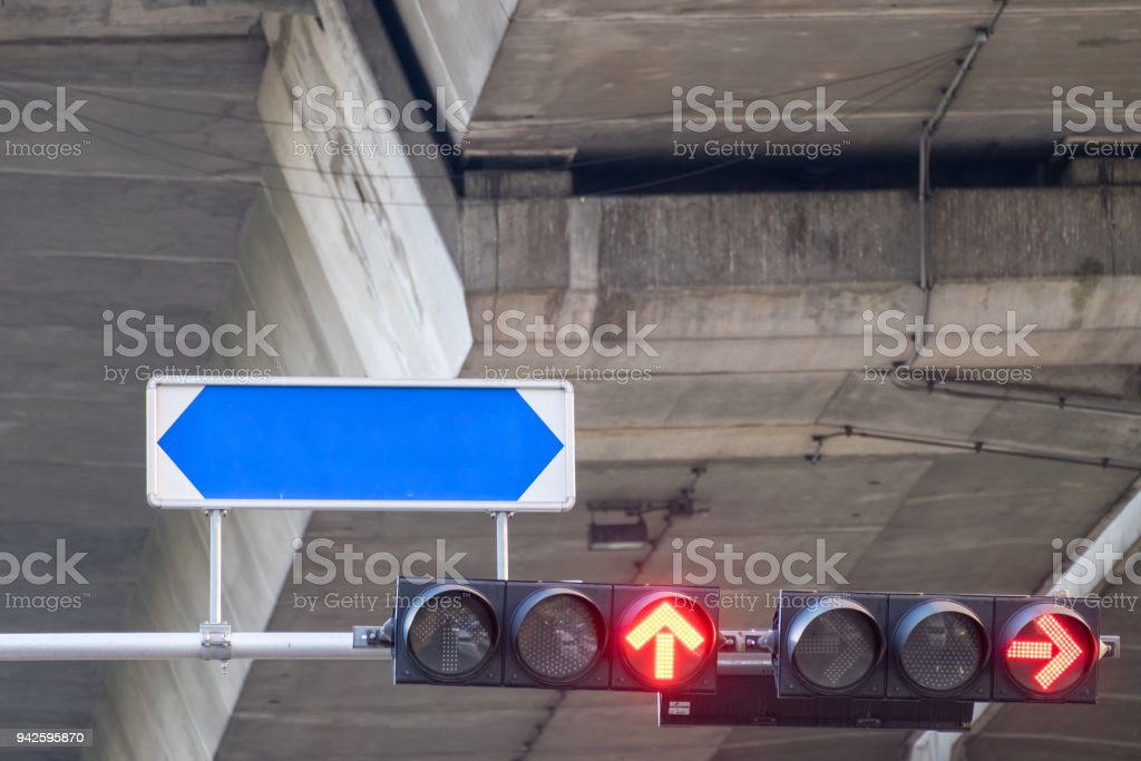 Traffic signal lights are red arrows to stop the car with street names board, which installed as separate stock photo