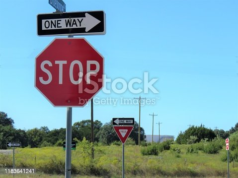 traffic signs: stop, one way, yield ; copy space
