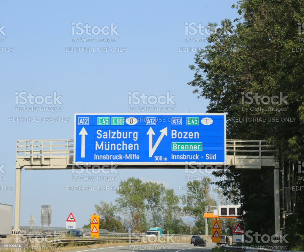 Traffic signs with directions to the city and the state borders - Royalty-free Alto Adige - Italy Stock Photo