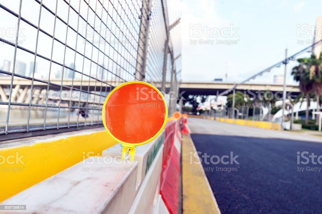 Traffic Signs,Red and white colored street barrier on empty road at night/Closed Road at Darkness stock photo