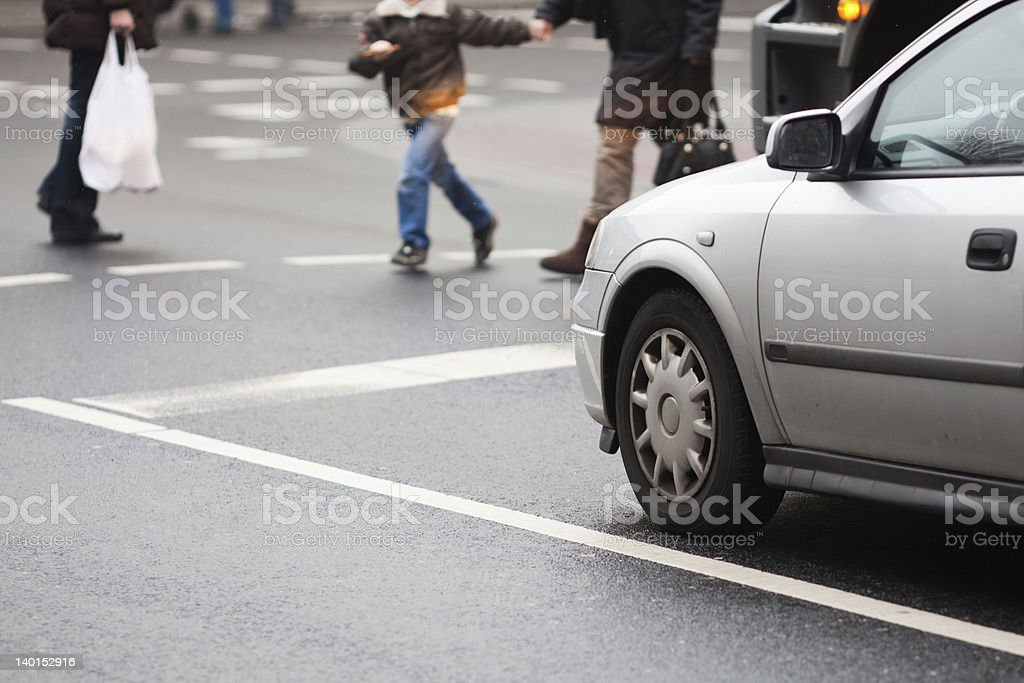 traffic situation with crossing people stock photo