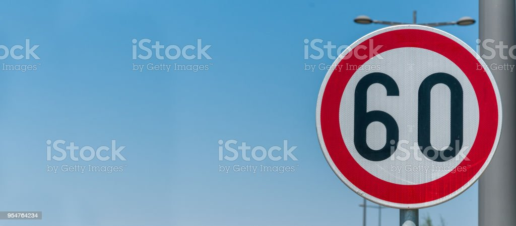 Traffic Speed Limit Sign For Restriction On 60 Kilometers Or Miles Per Hour With Blue Sky