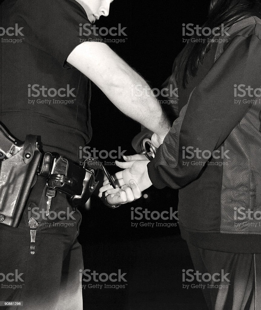 Traffic stop with driver being handcuffed by a policeman royalty-free stock photo