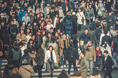 Tokyo, Japan - November 26, 2018 : Traffic stops for pedestrians crossing at Shibuya Crossing. It is one of the world's most famous scramble crosswalks.