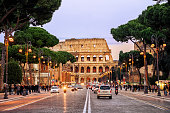 Rome, Italy - April 04: Traffic on the Via dei Fori Imperiali street in front of Colosseum in the evening, Rome, Italy, on April 04, 2013