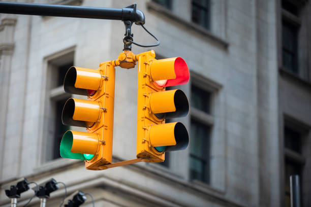 Traffic street light at a city intersection stock photo