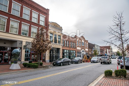 Spartanburg, S.C. / USA - November 16, 2019: Traffic street scene downtown, with cars and traditional architecture.