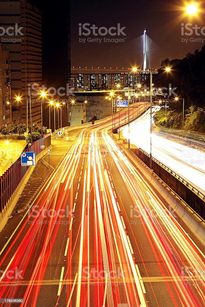 traffic through downtown at night royalty-free stock photo