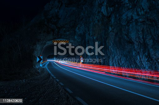 Traffic through tunnel at night