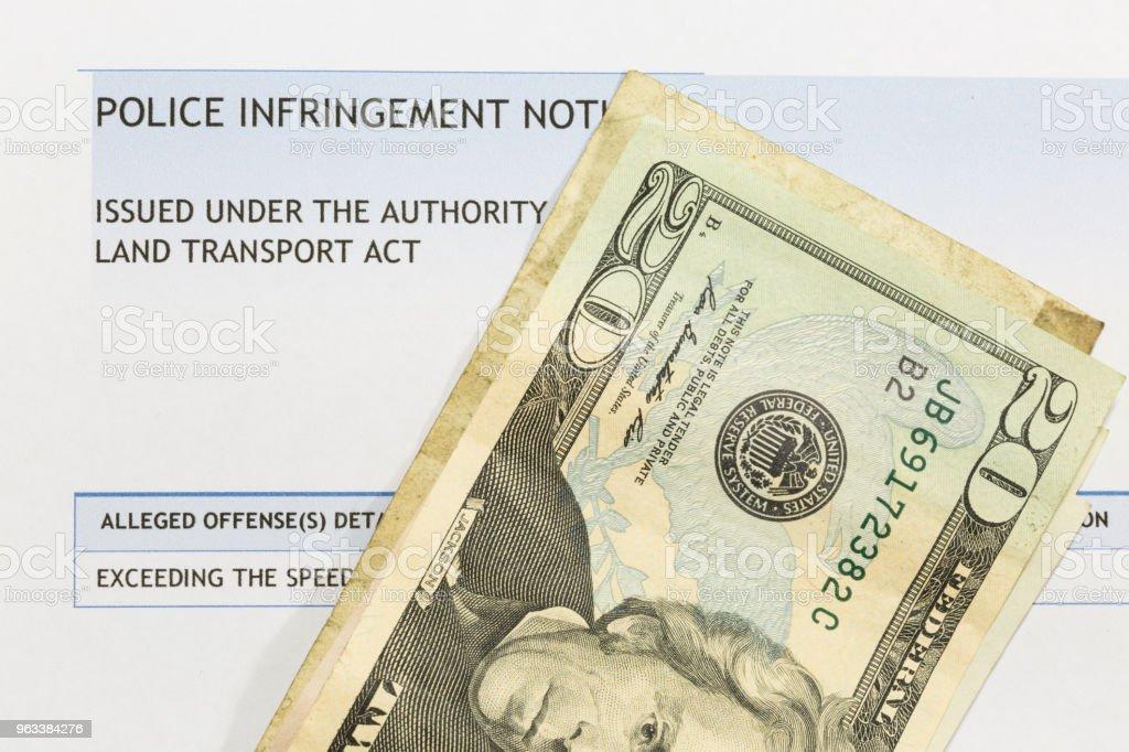 A traffic ticket with cash. - Zbiór zdjęć royalty-free (Australia)