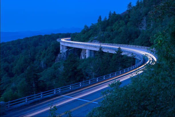 Traffic trails and blue hour over viaduct. stock photo