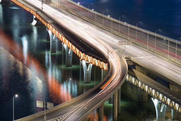 traffic trails on the highway - saturated color stock pictures, royalty-free photos & images