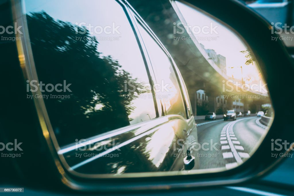 Traffic view from driving mirror stock photo