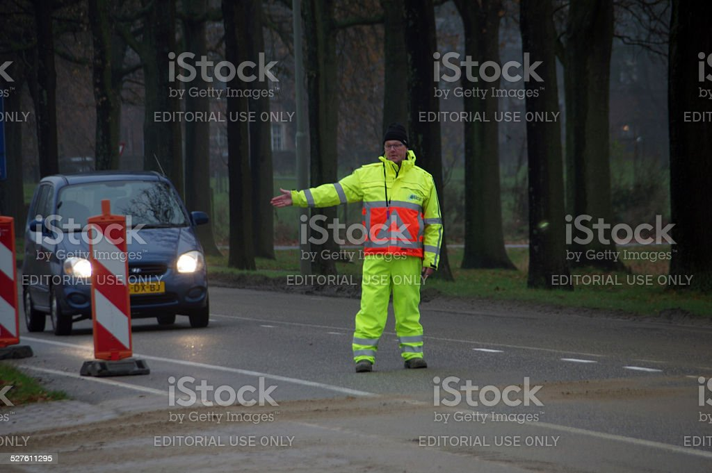Traffic warden busy with his work stock photo
