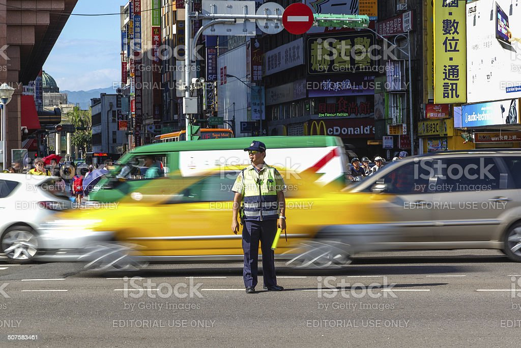 Traffic Warden Directs Peak Hour Traffic in Tapei City stock photo