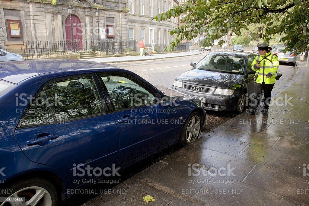 Traffic warden in UK stock photo