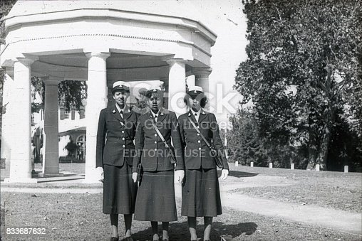 Washington D.C., USA, 1951. Three African American traffic wardens in a park in Washington DC. In the background is a pavilion. On the upper ledge is the word