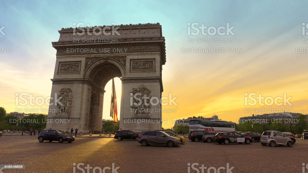 Traffic with Beautiful Sunset Over Arc De Triomphe. Paris, France stock photo