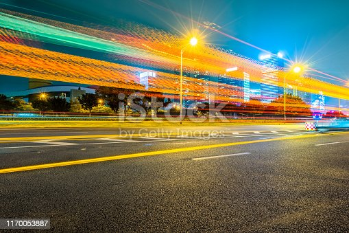 515009182 istock photo traffic with blur light through city at night 1170053887