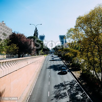 Madrid, Spain - Oct 26, 2019: Traffic with KIO towers or Gateway of Europe from Plaza de Castilla in background, Madrid, Spain