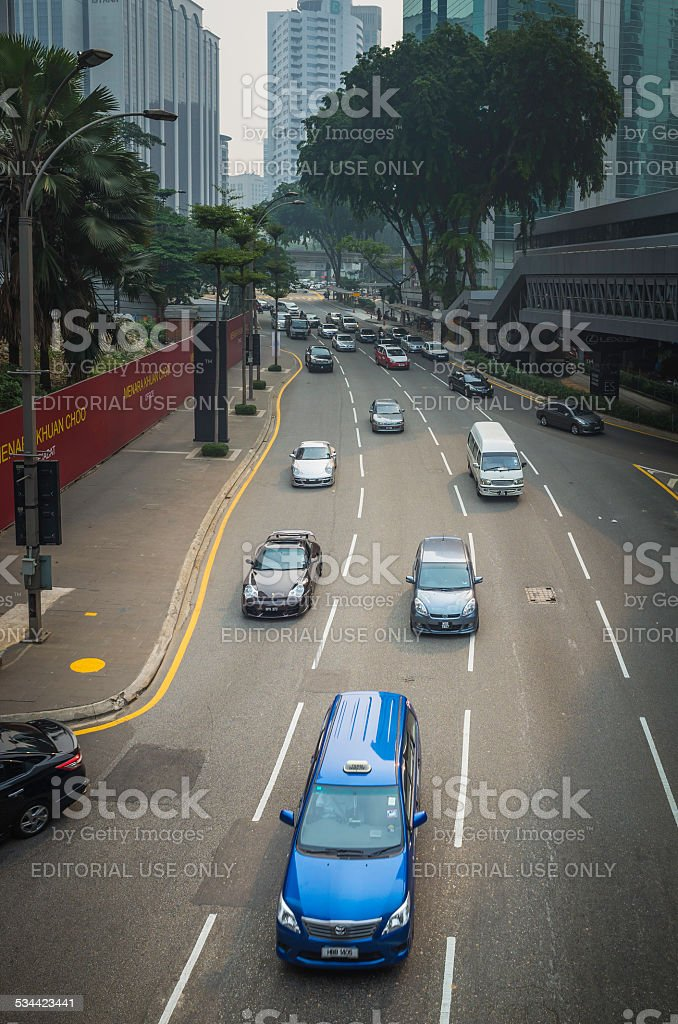 Traffic zooming through city streets between skyscrapers Kuala Lumpur Malaysia stock photo