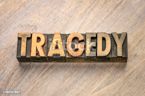 tragedy word abstract in vintage letterpress wood type printing blocks