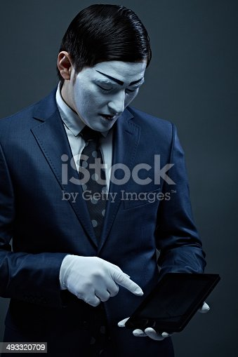 Business mime holding touchpad