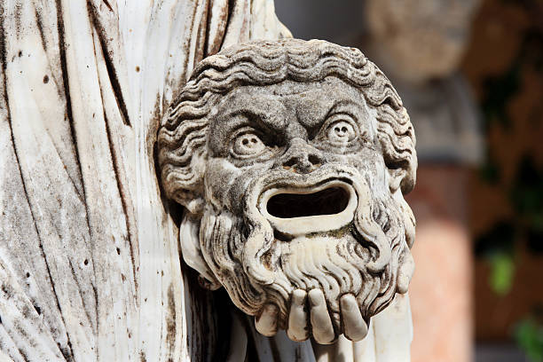 tragic mask in hand of greek statue of melpomene - tragedy mask stock photos and pictures
