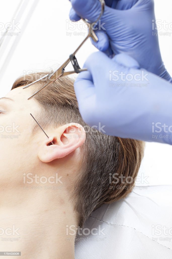 Tragus piercing royalty-free stock photo