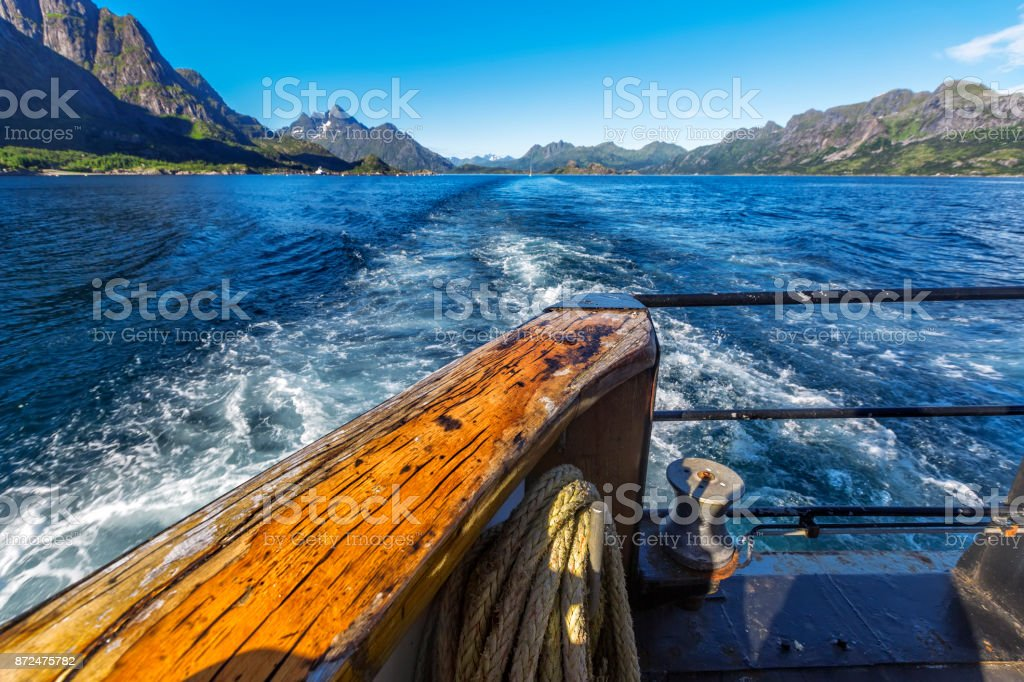Trail  behind of the ship on water surface on Trollfjord stock photo