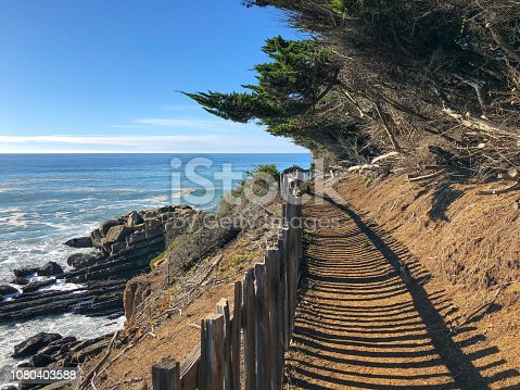 Trail by Ocean: Northern California on sunny day with old fence. The Sea ranch
