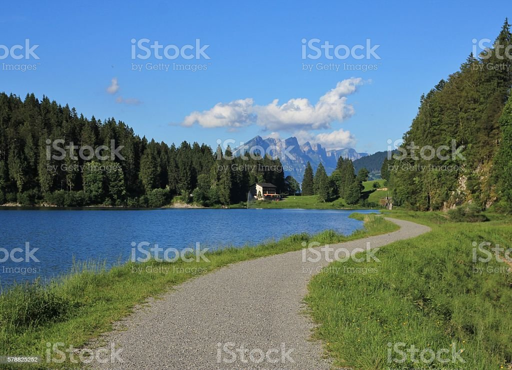 Trail leading around lake Obersee stock photo