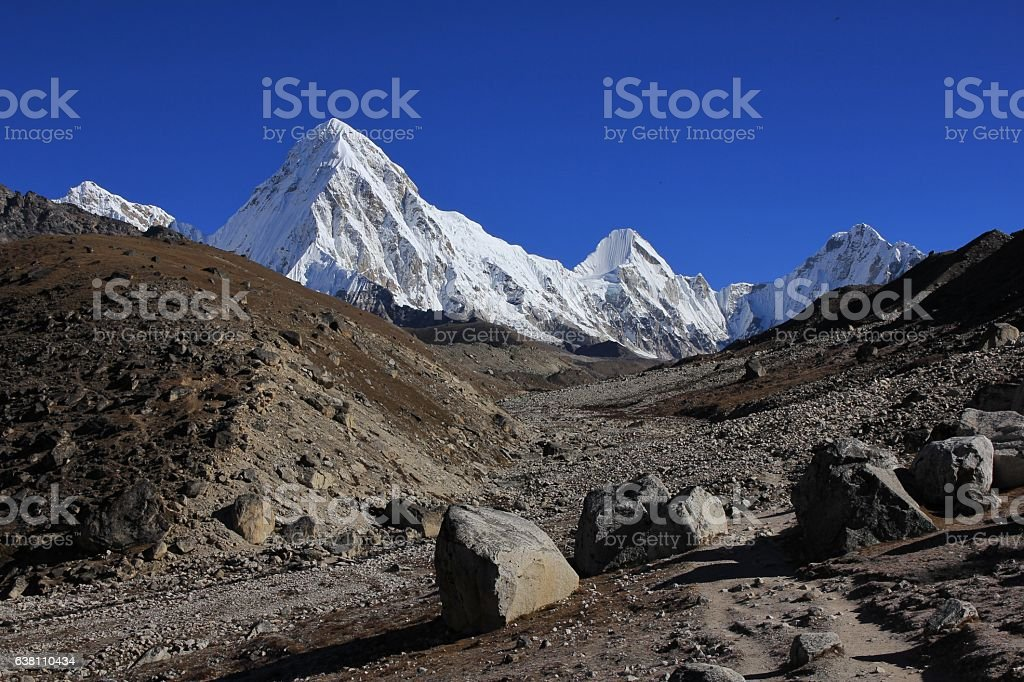 Trail leading towards Everest base camp and mount Pumori stock photo
