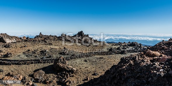 A Hiking trail passes between the sharp rocks on the slope of the Teide volcano.