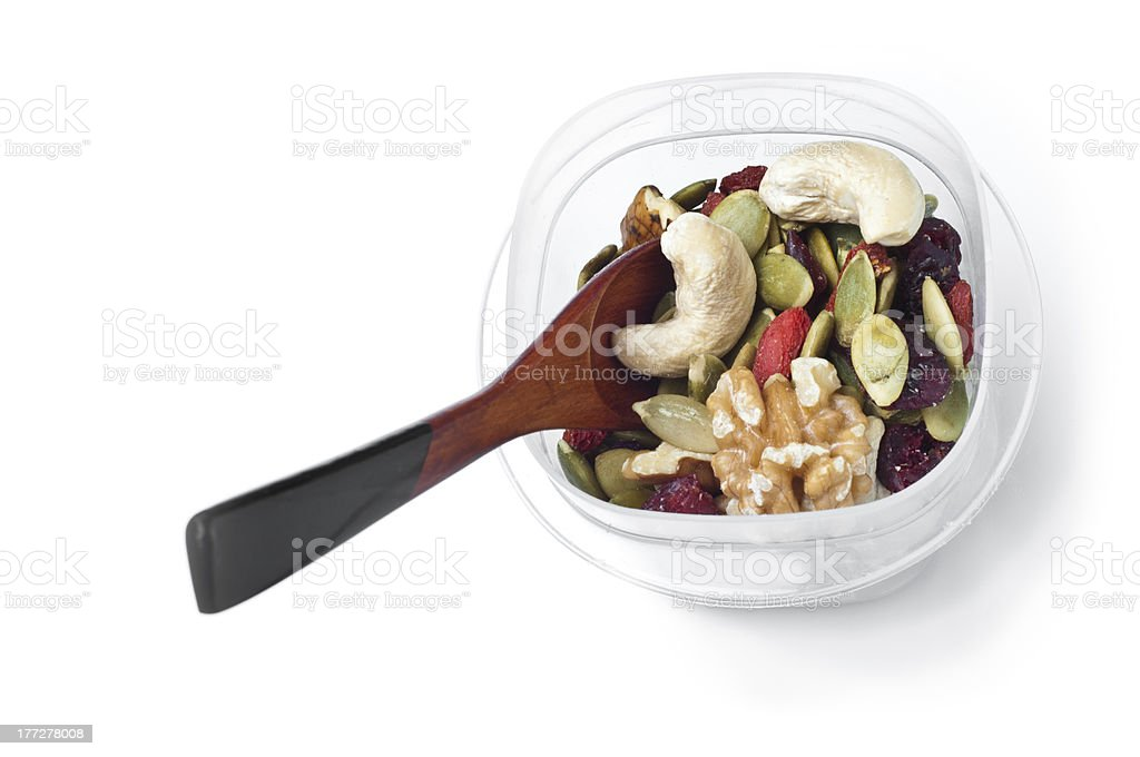 Trail mix container with spoon on white royalty-free stock photo
