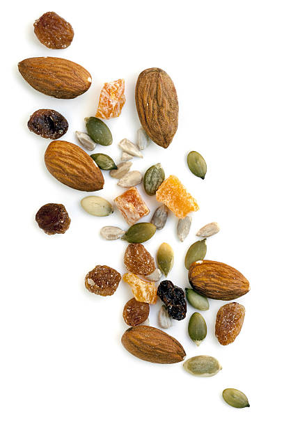 trail mix isolated - dried fruit stock photos and pictures