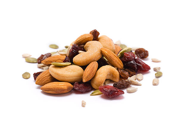 trail mix on white - dried fruit stock photos and pictures