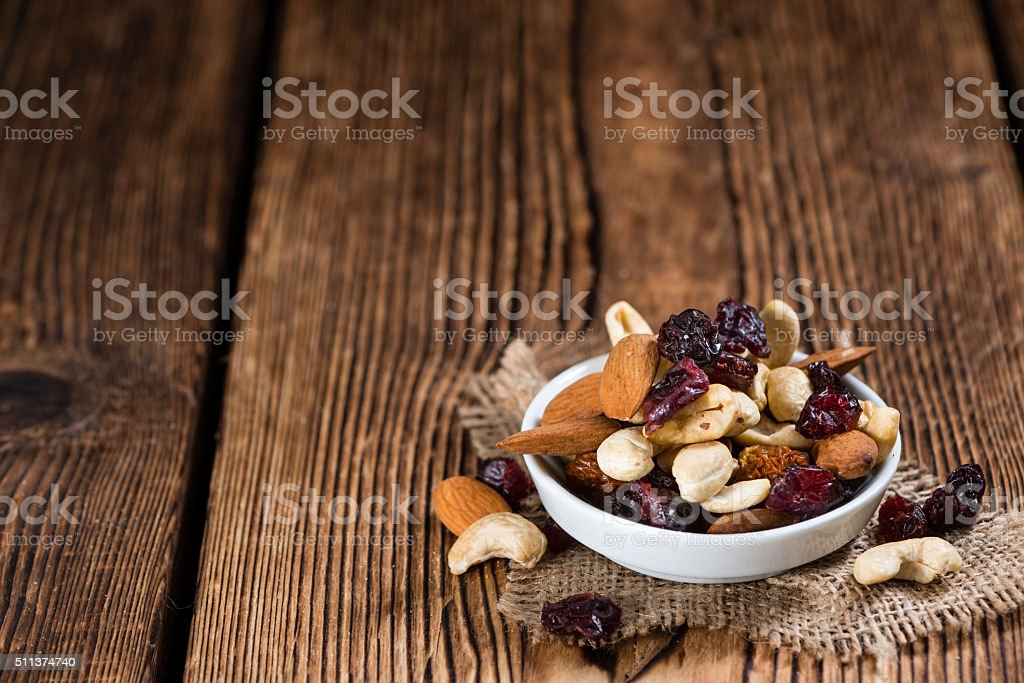 Trail Mix on wooden background stock photo