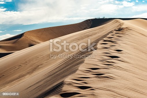 Trail of footprints climbs upward in the Great Sand Dunes National Park in Colorado
