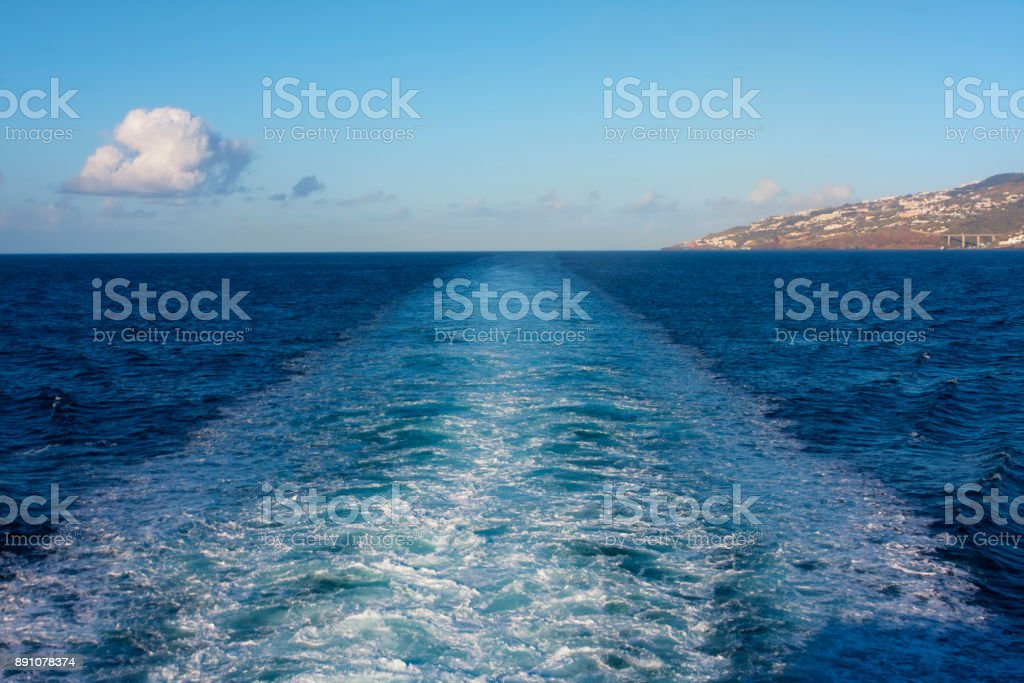 Trail of the ship in the ocean in the early morning stock photo