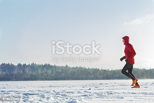 istock Trail racing runner wearing sportswear on winter training session outdoors 618423842